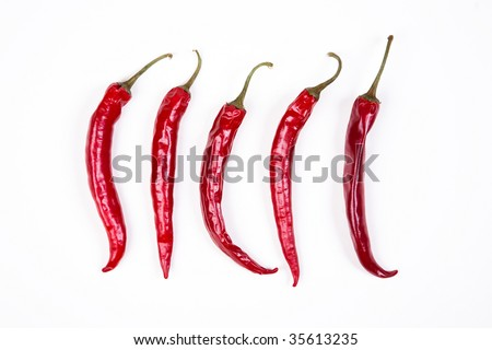 5 Red chili peppers on white - stock photo