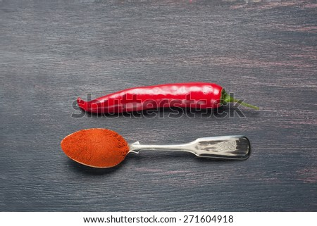 red chilly peppers  on a wooden table,  selective focus - stock photo