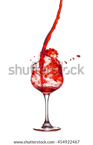Red cocktail glass splash out on a white background.