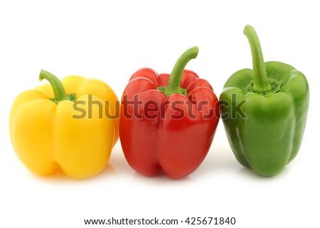red, green and yellow pepper (capsicum) on a white background - stock photo