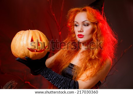 red-haired girl in a witch costume. masquerade. halloween, autumn