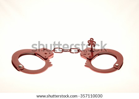 Red handcuffs as a sex toy  - stock photo