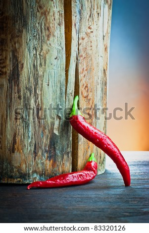 ,red hot chilli pepper on wood, - stock photo