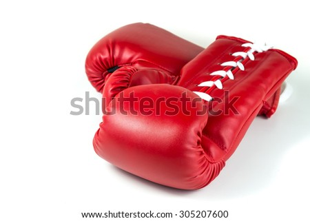 red leather boxing gloves on white isolated background - stock photo
