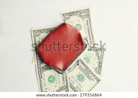 red leather wallet with dollars. Isolated on white