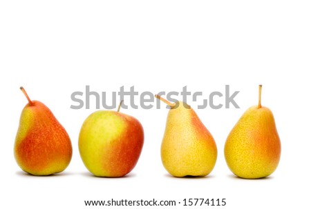 3 red pears in a line and one red apple . - stock photo