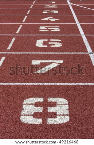 Red race track with white numbers - stock photo