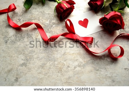 3 red roses,red heart message card and ribbon.Image of Valentines day - stock photo