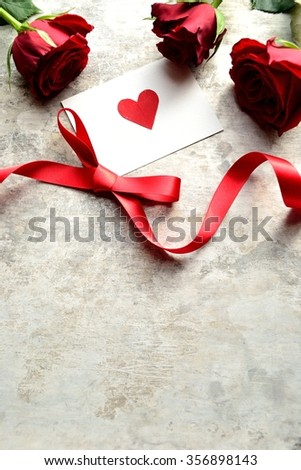 3 red roses,red heart message card and ribbon.Image of Valentines day
