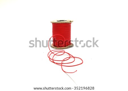 Red thread on the white background - stock photo