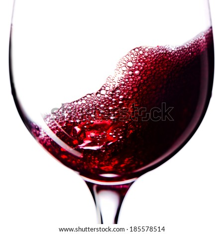 Red wine in wineglass  isolated on white background - stock photo