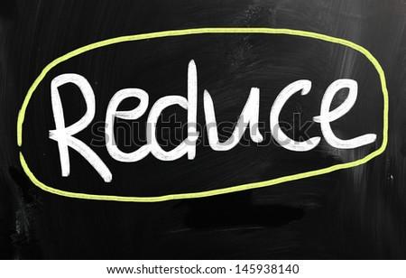 """Reduce"" handwritten with white chalk on a blackboard - stock photo"