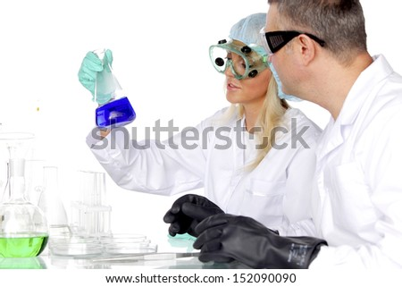researchers holding a secret green chemical substance - stock photo