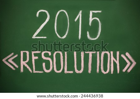2015 Resolution written with chalk on a green board.  - stock photo
