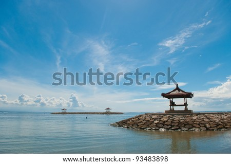 rest-houses at sanur beach on bali - stock photo