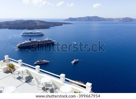 Restaurant terrace with sea view. White architecture on Santorini island, Greece. - stock photo