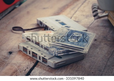 Retro Compact Cassettes tape on wood table.Vintage effected photo
