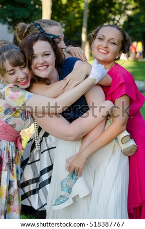retro-style girls having fun on a summer picnic in a park