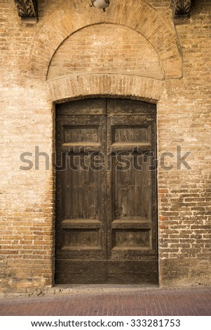 Retro Wooden Door Outside Old Italian House In A Small Town Of San  Germignano, Tuscany