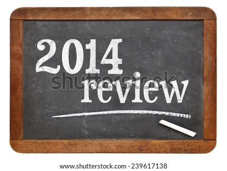 2014 review - year summary concept on a vintage slate blackboard - stock photo