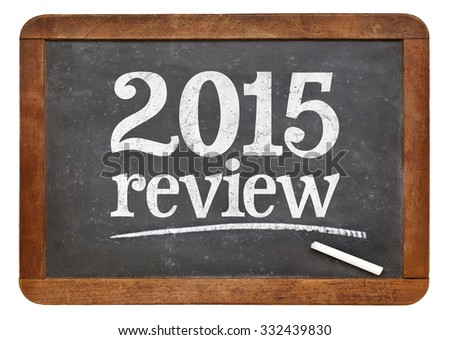 2015 review - year summary concept on a vintage slate blackboard - stock photo