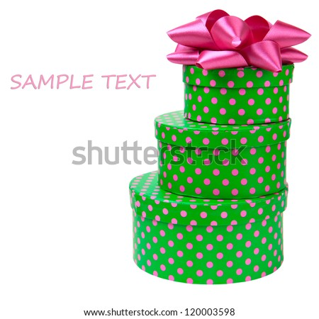 Ribbon bow on gift boxes with polka dots isolated on white background - stock photo