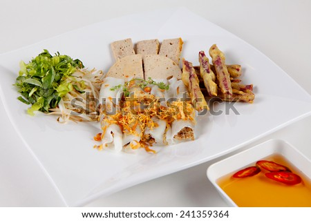 Rice flour rolls and stuffed with ground pork, minced wood ear mushroom, and minced shallots so called as BANH CUON, typical Vietnamese cuisine - stock photo