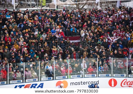20.01.2018. RIGA, LATVIA. Hockey fans at tribune with Latvian flag , during  Kontinental Hockey League (KHL) 2017/2018 season game, Winter Ice Break  Dinamo Riga vs. Dinamo Minsk