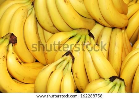 ripe fruit bananas on store shelves                       - stock photo