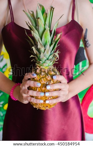 ripe fruit pineapple in the hands of women .