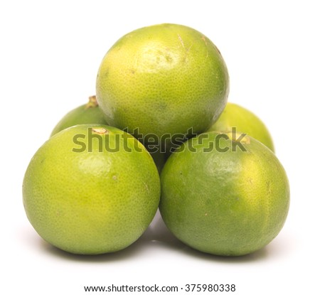 ripe limes isolated on a white background - stock photo