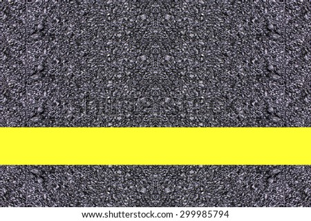 road Asphalt surface of the road with a yellow line. - stock photo