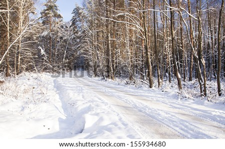 road   in a winter season. the road is covered with snow - stock photo