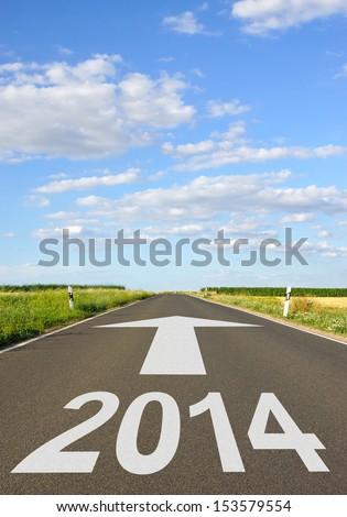 2014 - Road with Arrow - stock photo