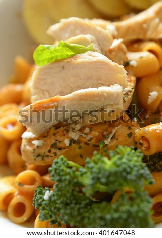 Roast chicken meat on a plate with broccoli