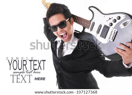 rocker-style businessman holding a guitar, isolated on white background - stock photo