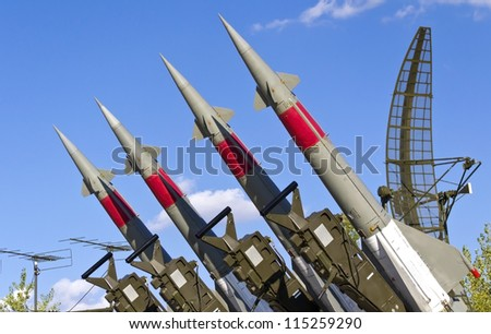 rockets of a surface-to-air missile system are aimed in the sky - stock photo