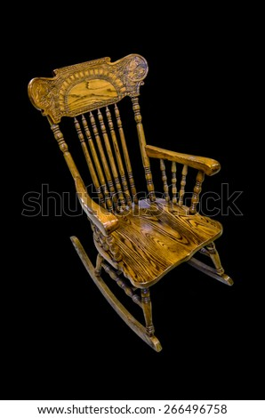 rocking-chair at black background - stock photo
