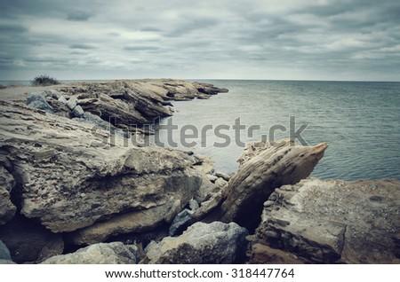 Rocks and dark sea - stock photo