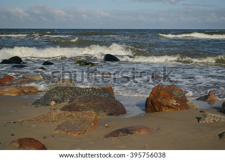 rocks on the shore of the Baltic Sea on a cold winter morning
