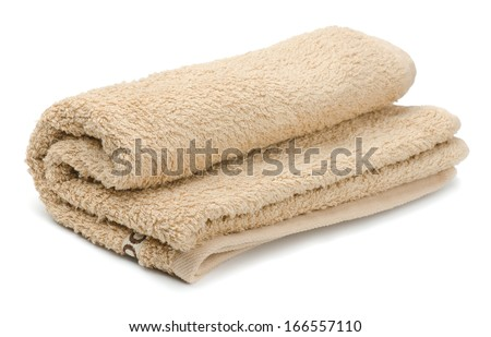 Rolled beige bath terry towels - stock photo