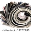 rolled up magazine - stock photo