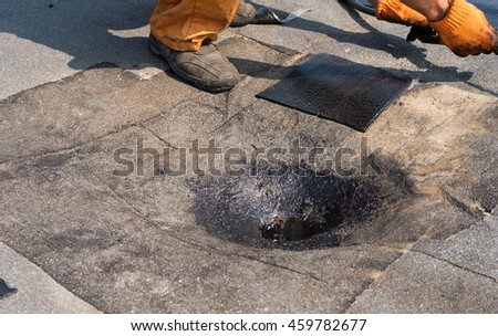 Roofer Doing Repair Roof Drain. Flat Roof Installation. Heating And Melting  Bitumen Roofing Felt