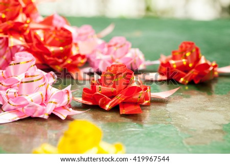 Rose scattering coin, for ordination ceremony - stock photo