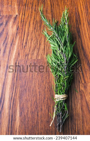 rosemary branch on wooden table