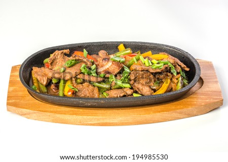 Rosted meat with vegetables on pan