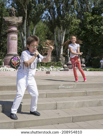 ROSTOV-ON-DON,RUSSIA-JULY 27- Talented unidentified children sing in celebration of the Navy at the monument to Admiral Ushakov on July 27,2014 in Rostov-on-Don       - stock photo