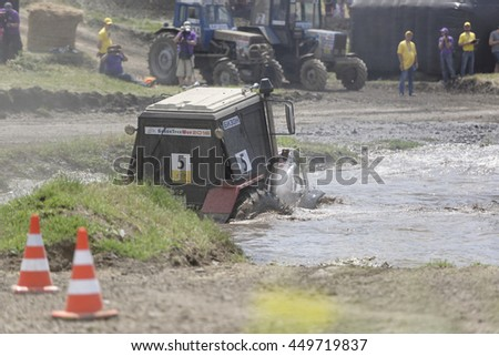Rostov-on-Don, Russia- June 05,2016: Competition for agricultural tractors on the Bizon Track Show.Tractor overcome the water barrier. Press pictures of the race