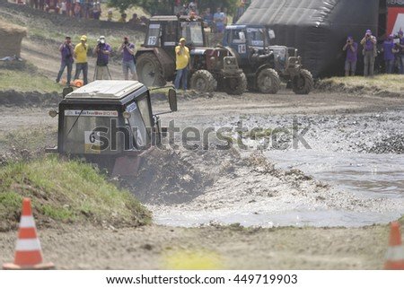 Rostov-on-Don, Russia- June 05,2016: Competition for agricultural tractors on the Bizon Track Show.Tractor overcome the water barrier.Spectators watch the races.Press pictures of the race