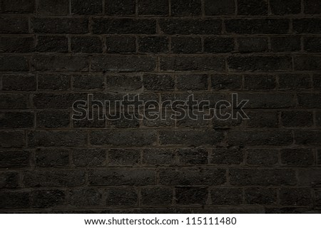 Rough  black brick wall - stock photo